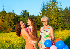 Beautiful happy family  outdoors during sunset with balloons Stock Photography