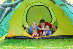 Beautiful happy family in tent Stock Images