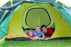 Beautiful happy family in tent Royalty Free Stock Image