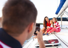 Beautiful happy family with two daughters having great time at t Royalty Free Stock Images