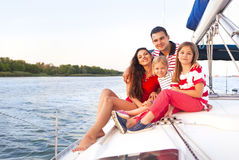Beautiful happy family with two daughters having great time at t stock photography