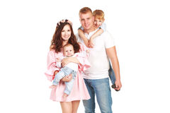 Beautiful happy family with two sons. Beautiful happy couple of yound and happy parents  with two sons, isolated on white Stock Image