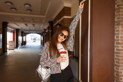 Beautiful happy fashionable young woman with coffee royalty free stock photo
