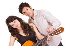 Beautiful happy female guitar student and teacher Stock Photography