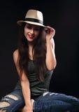 Beautiful happy female model with long brown hair posing in cowb Stock Images