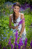 Beautiful  happy female  in the wildflowers Royalty Free Stock Image