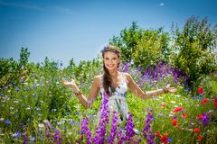 Beautiful  happy female  in the wildflowers Royalty Free Stock Photo