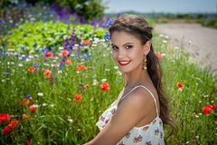 Beautiful  happy female  in the wildflowers Royalty Free Stock Photos
