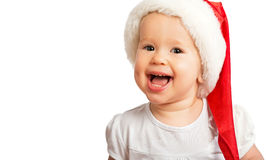 Beautiful happy funny baby in a Christmas hat  isolated Stock Image