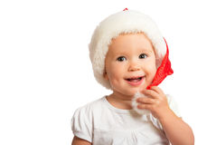 Beautiful happy funny baby in a Christmas hat  isolated Stock Photography