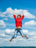 Beautiful happy funny young redhead woman jumps Royalty Free Stock Images