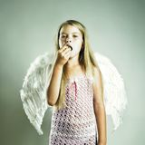 Beautiful happy girl with angel wings. Portrait of a beautiful happy girl with angel wings Stock Photo