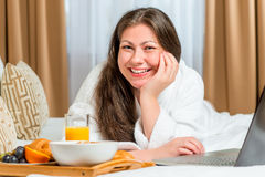 Beautiful and happy girl on the bed Stock Image