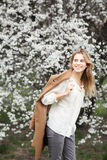 Beautiful happy  girl  in  blossom garden on a spring day Royalty Free Stock Images