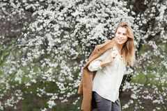 Beautiful happy girl  in  blossom garden on a spring day Stock Photography
