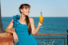 Beautiful happy girl with a drink Stock Photography