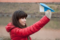 Beautiful happy girl flies a paper airplane Royalty Free Stock Photos