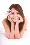 Beautiful happy girl with flower in bed. stock images