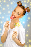 Beautiful happy girl with freckles holding and eating sweets candy lollipop with facial expression Stock Image