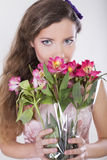 Beautiful happy girl give a wild orchid Stock Photo
