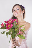 Beautiful happy girl give a wild orchid Royalty Free Stock Image