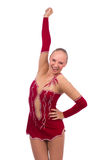 Beautiful happy girl gymnast with hand over head Royalty Free Stock Photos