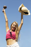 Beautiful happy girl hands up with maracas and hat half-length Royalty Free Stock Image