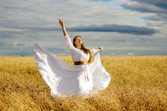 Beautiful Happy Girl Having Fun on the Wheat Field Stock Photos