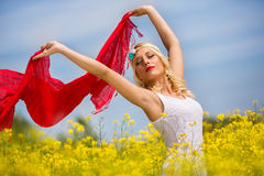 Beautiful happy girl having fun on the yellow field, Stock Images