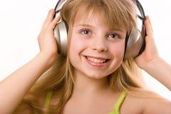 Beautiful happy girl with headphones Stock Photo
