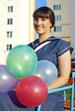 Beautiful happy girl holding balloons Royalty Free Stock Photos