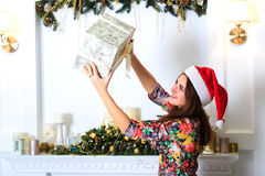 Beautiful happy girl holding a box with christmas gift Stock Image