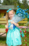 Beautiful happy girl kid with a bouquet of flowers on birthday in park. Celebration concept and childhood, love Royalty Free Stock Photos