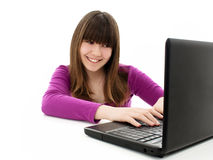 Beautiful and happy girl with a laptop Royalty Free Stock Photo