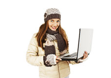 Beautiful and happy girl with a laptop. Winter style. Isolated on white background Stock Images