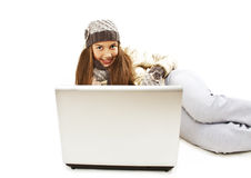 Beautiful and happy girl with a laptop. Winter style. Isolated on white background Royalty Free Stock Images