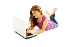 Beautiful and happy girl with a laptop. On white background Stock Photos