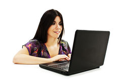 Beautiful and happy girl with a laptop Royalty Free Stock Photos