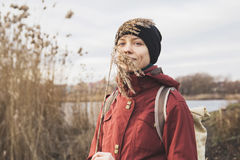 Beautiful happy girl near a lake. In nature with a cane in his hand, harmonious sensations. traveler girl enjoying life and meditates Stock Images