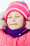 Beautiful happy girl in the red jacket Royalty Free Stock Photography