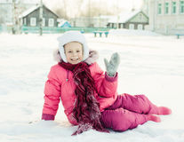 Beautiful happy girl in the red jacket Royalty Free Stock Photo