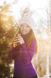 Beautiful happy girl in the red jacket in the winter Royalty Free Stock Photography