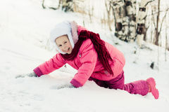 Beautiful happy girl in the red jacket Royalty Free Stock Image