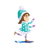 Beautiful, happy girl riding on ice skates at the rink Royalty Free Stock Photo