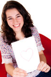 Beautiful and Happy Girl Showing Her Heart Royalty Free Stock Photo
