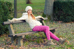 Beautiful happy girl sitting in autumn park Stock Photography