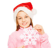Beautiful happy girl with snowflake in Santa hat Stock Photos