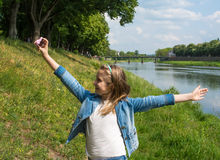 Beautiful happy girl taking a selfie Stock Photography
