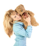 Beautiful happy girl with teddy bear Stock Photo