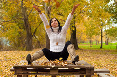 Beautiful happy girl throwing leaves in the air Royalty Free Stock Photography
